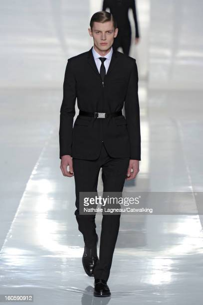 A model walks the runway at the Dior Homme Autumn Winter 2013 fashion show during Paris Menswear Fashion Week on January 19 2013 in Paris France