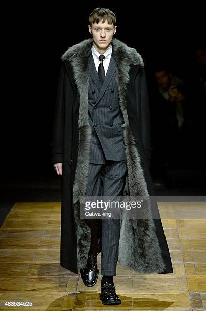 A model walks the runway at the Dior Homme Autumn Winter 2014 fashion show during Paris Menswear Fashion Week on January 18 2014 in Paris France