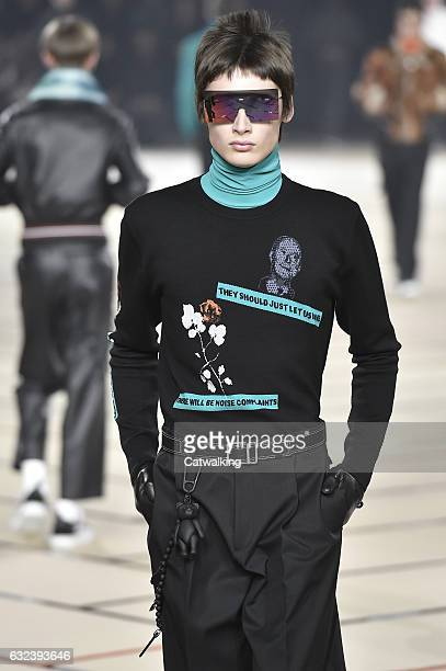 A model walks the runway at the Dior Homme Autumn Winter 2017 fashion show during Paris Menswear Fashion Week on January 21 2017 in Paris France