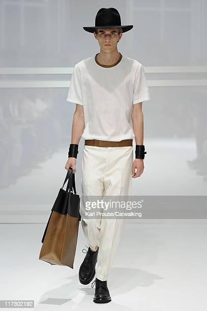 A model walks the runway at the Dior Homme menswear fashion show during Paris Fashion Menswear Week on June 25 2011 in Paris France