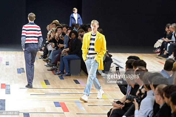 A model walks the runway at the Dior Homme Spring Summer 2015 fashion show during Paris Menswear Fashion Week on June 28 2014 in Paris France