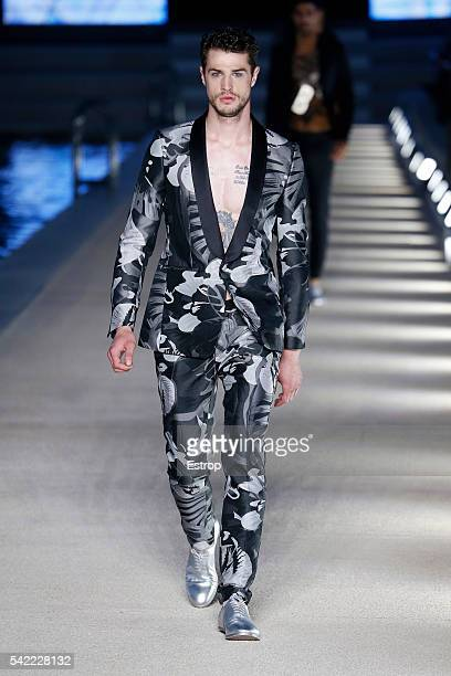 A model walks the runway at the Dirk Bikkembergs show during Milan Men's Fashion Week SS17 on June 20 2016 in Milan Italy