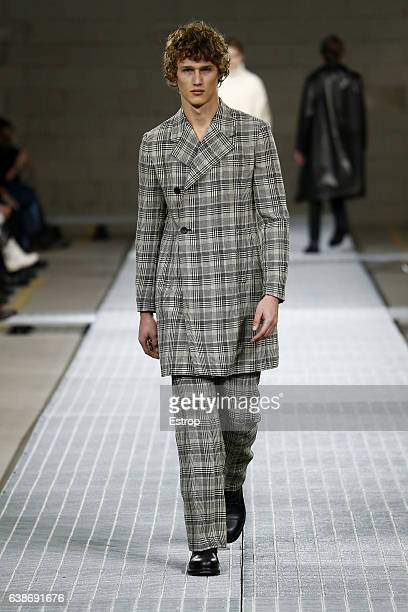 A model walks the runway at the Dirk Bikkembergs show during Milan Men's Fashion Week Fall/Winter 2017/18 on January 15 2017 in Milan Italy
