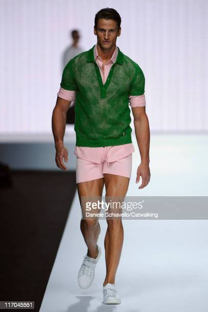 A model walks the runway at the Dirk Bikkembergs Sport Couture menswear fashion show during Milan Fashion Menswear Week on June 20 2011 in Milan Italy