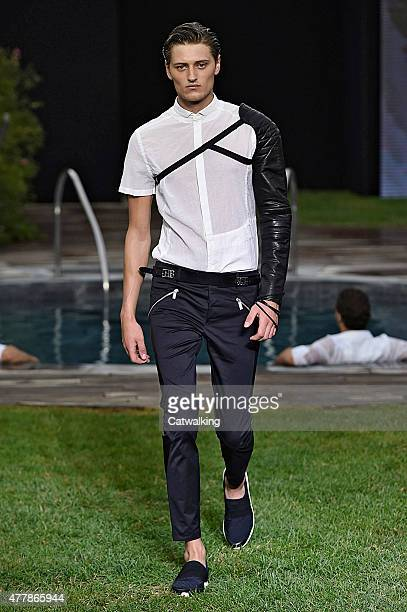 A model walks the runway at the Dirk Bikkembergs Spring Summer 2015 fashion show during Milan Menswear Fashion Week on June 19 2015 in Milan Italy
