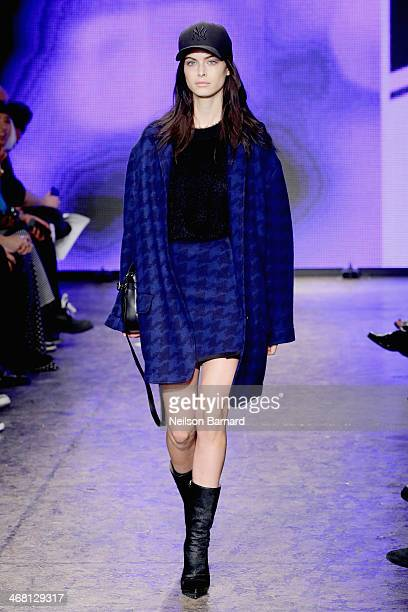 A model walks the runway at the DKNY Women's fashion show during MercedesBenz Fashion Week Fall 2014 on February 9 2014 in New York City