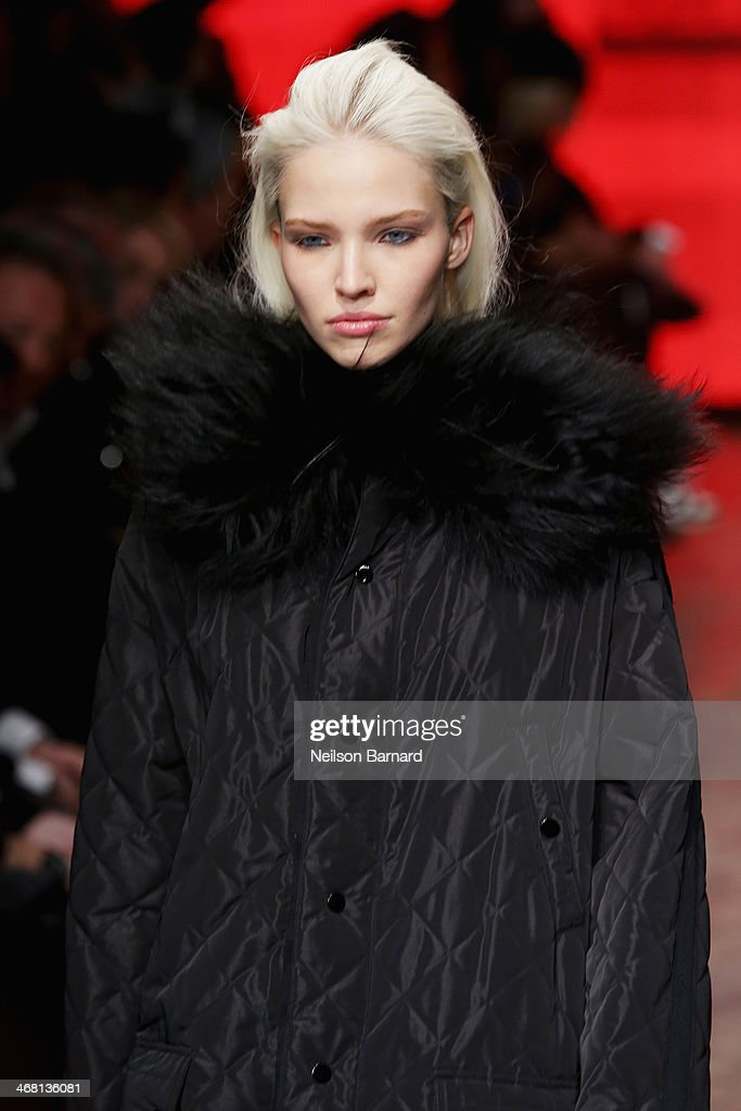 A model walks the runway at the DKNY Women's fashion show during Mercedes-Benz Fashion Week Fall 2014 on February 9, 2014 in New York City.