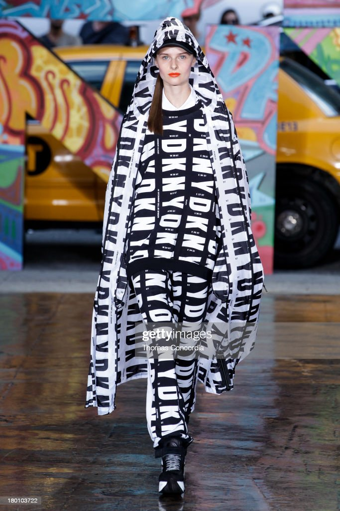 A model walks the runway at the DKNY Women's Spring 2014 fashion show during Mercedes-Benz Fashion Week at Cedar Lake in New York City on September 8, 2013.
