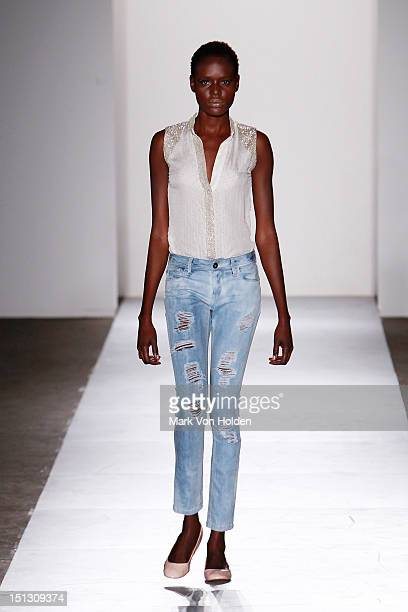 A model walks the runway at the DL 1961 Premium Denim spring 2013 fashion show during MercedesBenz Fashion Week at Pier 57 on September 5 2012 in New...