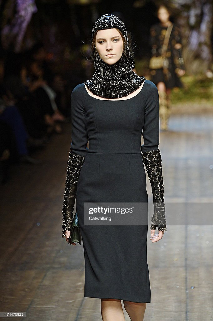 A model walks the runway at the Dolce & Gabbana Autumn Winter 2014 fashion show during Milan Fashion Week on February 23, 2014 in Milan, Italy.