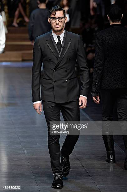 A model walks the runway at the Dolce Gabbana Autumn Winter 2015 fashion show during Milan Menswear Fashion Week on January 17 2015 in Milan Italy