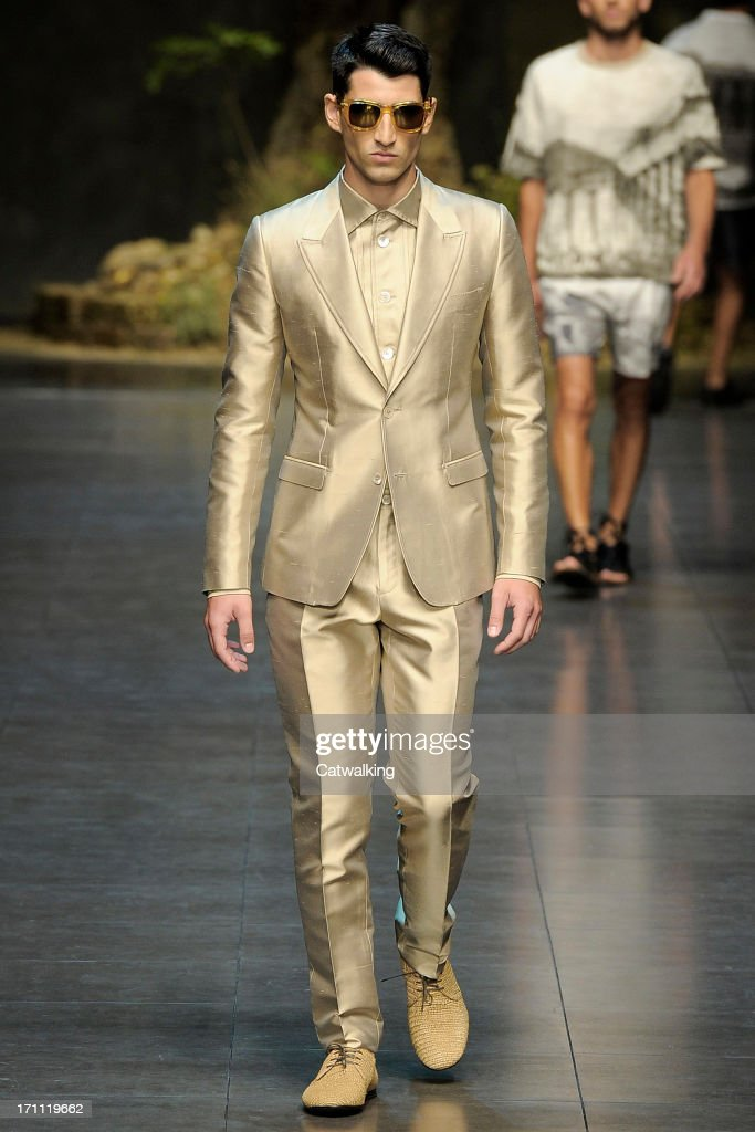 A model walks the runway at the Dolce & Gabbana Spring Summer 2014 fashion show during Milan Menswear Fashion Week on June 22, 2013 in Milan, Italy.