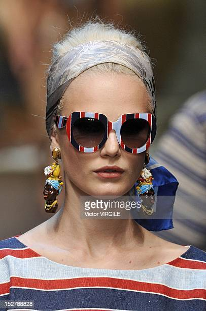 A model walks the runway at the Dolce Gabbana Spring/Summer 2013 fashion show as part of Milan Womenswear Fashion Week on September 23 2012 in Milan...