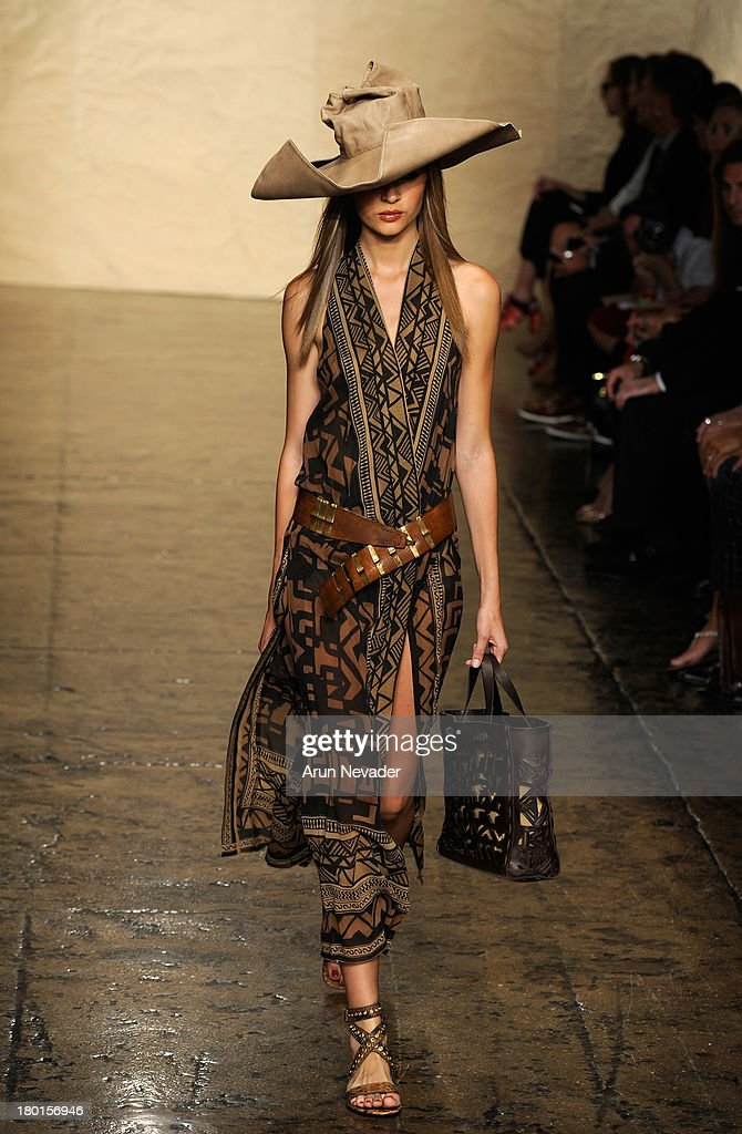 A model walks the runway at the Donna Karan New York fashion show during Mercedes-Benz Fashion Week Spring 2014 on September 9, 2013 in New York City.
