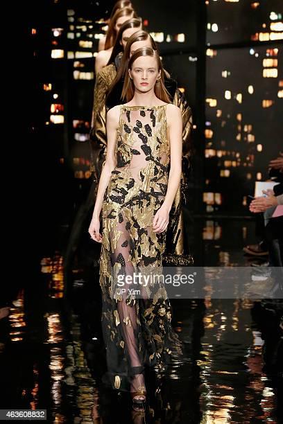 A model walks the runway at the Donna Karan New York fashion show during MercedesBenz Fashion Week Fall 2015 on February 16 2015 in New York City