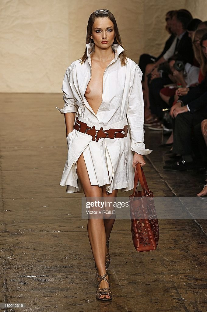 A model walks the runway at the Donna Karan New York Ready to Wear fashion show during Mercedes-Benz Fashion Week Spring Summer 2014 on September 9, 2013 in New York City.