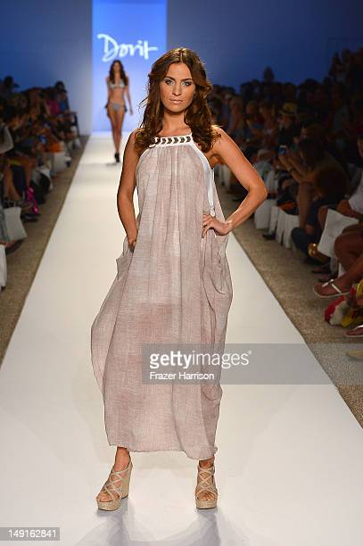 A model walks the runway at the Dorit show during MercedesBenz Fashion Week Swim 2013 Official Coverage at The Raleigh on July 23 2012 in Miami Beach...