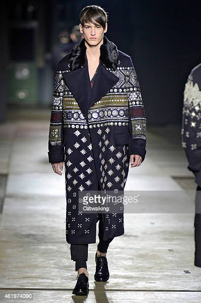 A model walks the runway at the Dries Van Noten Autumn Winter 2015 fashion show during Paris Menswear Fashion Week on January 22 2015 in Paris France