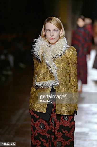 A model walks the runway at the Dries Van Noten Autumn Winter 2015 fashion show during Paris Fashion Week on March 4 2015 in Paris France