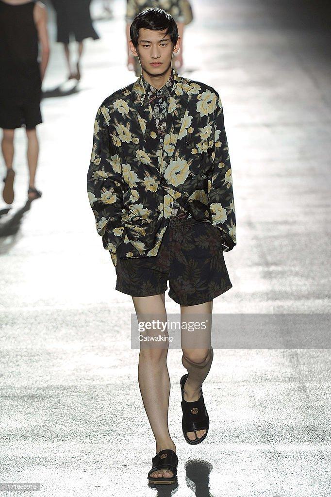 A model walks the runway at the Dries Van Noten Spring Summer 2014 fashion show during Paris Menswear Fashion Week on June 27, 2013 in Paris, France.