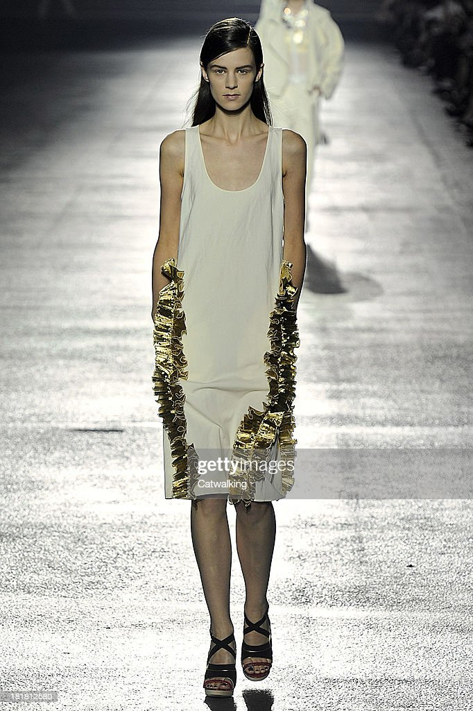 A model walks the runway at the Dries Van Noten Spring Summer 2014 fashion show during Paris Fashion Week on September 25, 2013 in Paris, France.
