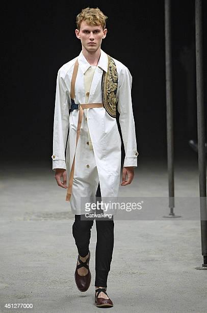 A model walks the runway at the Dries Van Noten Spring Summer 2015 fashion show during Paris Menswear Fashion Week on June 26 2014 in Paris France