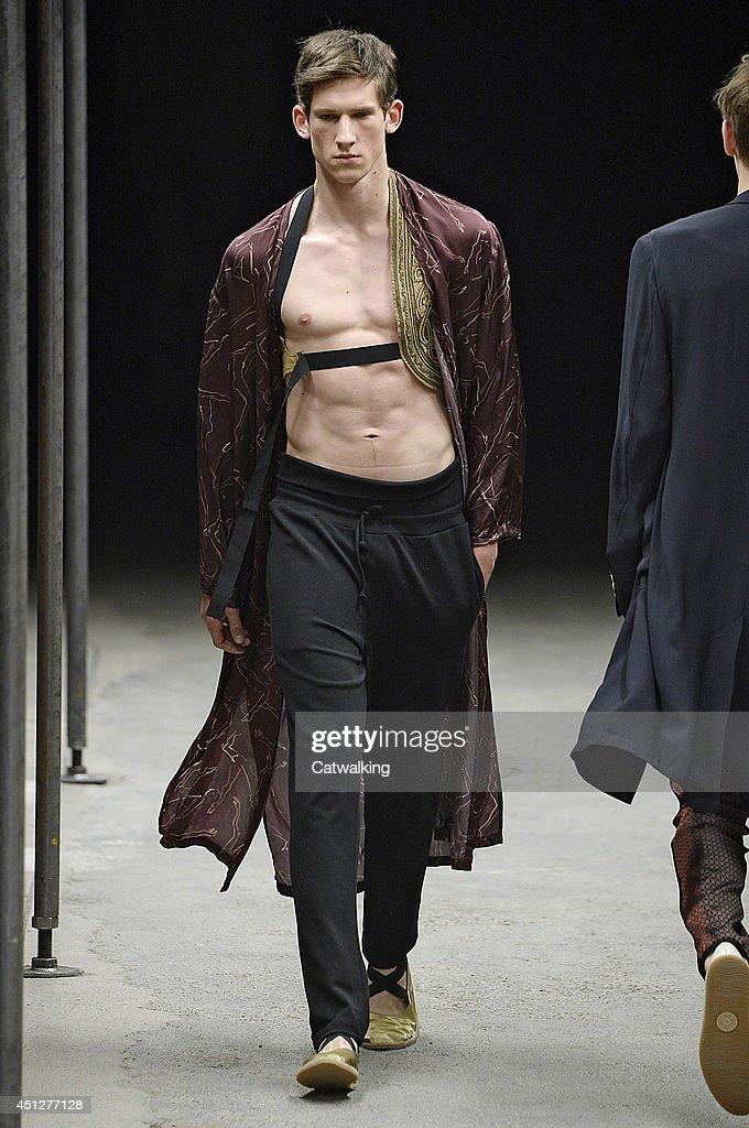 A model walks the runway at the Dries Van Noten Spring Summer 2015 fashion show during Paris Menswear Fashion Week on June 26, 2014 in Paris, France.