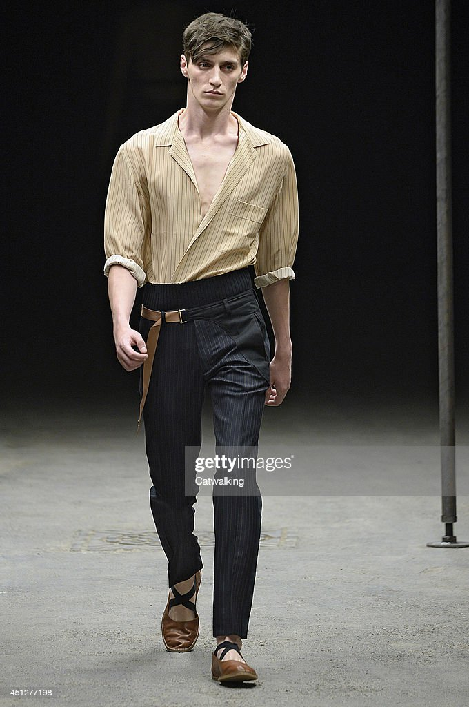 A model walks the runway at the Dries Van Noten Spring Summer 2015 fashion show during Paris Menswear Fashion Week on June 26, 2014 in Paris, France.