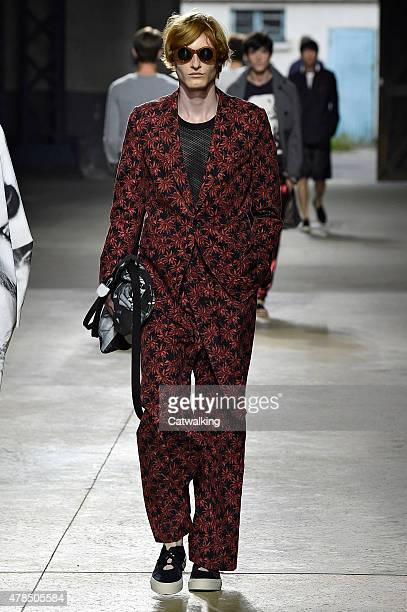 A model walks the runway at the Dries Van Noten Spring Summer 2016 fashion show during Paris Menswear Fashion Week on June 25 2015 in Paris France