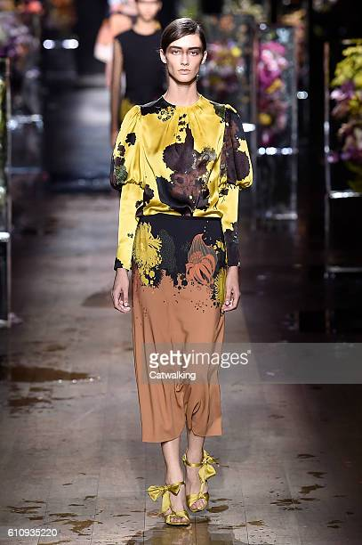A model walks the runway at the Dries Van Noten Spring Summer 2017 fashion show during Paris Fashion Week on September 28 2016 in Paris France