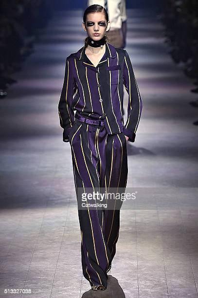 A model walks the runway at the Dries Van Noten Winter 2016 fashion show during Paris Fashion Week on March 2 2016 in Paris France