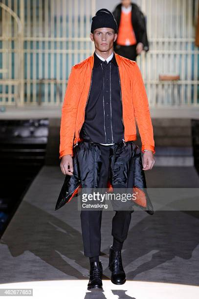 A model walks the runway at the DSquared2 Autumn Winter 2014 fashion show during Milan Menswear Fashion Week on January 14 2014 in Milan Italy