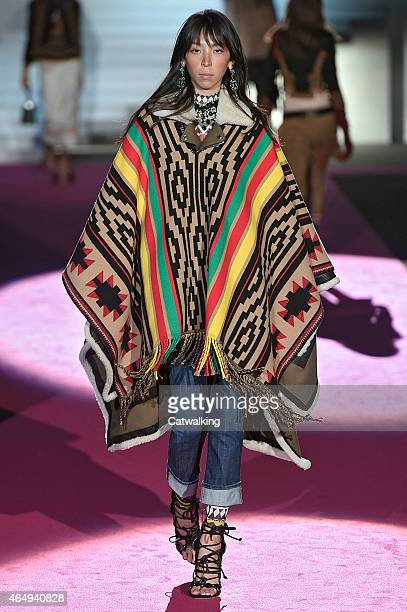 A model walks the runway at the DSquared2 Autumn Winter 2015 fashion show during Milan Fashion Week on March 2 2015 in Milan Italy
