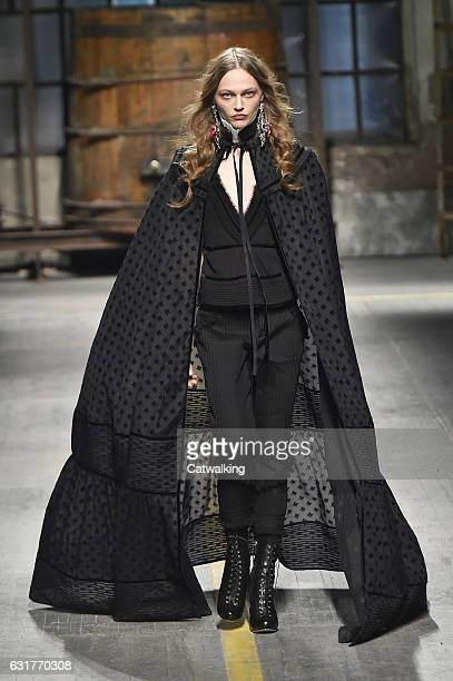 A model walks the runway at the DSquared2 Autumn Winter 2017 fashion show during Milan Menswear Fashion Week on January 15 2017 in Milan Italy