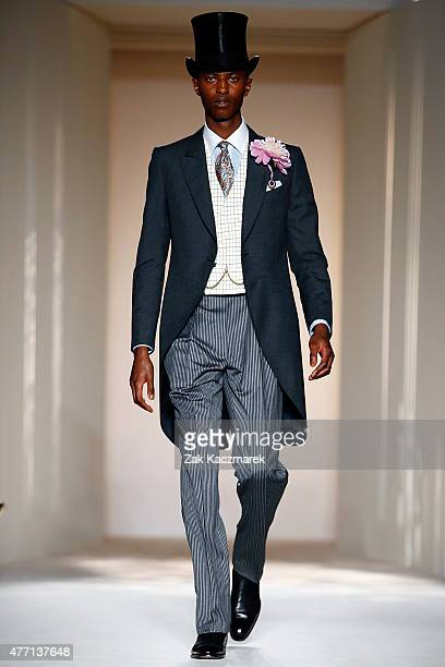 A model walks the runway at the dunhill show during The London Collections Men SS16 at Phillips Gallery on June 14 2015 in London England
