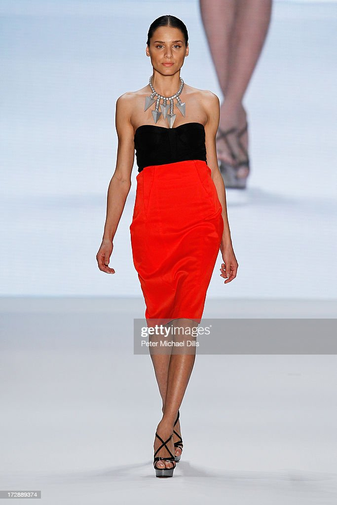 A model walks the runway at the Ece Goezen, Nazli Bozdag, Nevra Karaca No. 7 Show during Mercedes-Benz Fashion Week Spring/Summer 2014 at Brandenburg Gate on July 5, 2013 in Berlin, Germany.