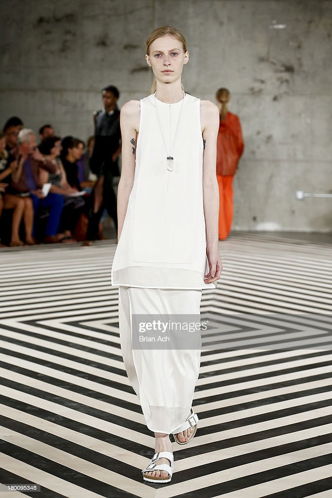 A model walks the runway at the Edun fashion show during Mercedes-Benz Fashion Week Spring 2014 at Skylight Modern on September 8, 2013 in New York City.