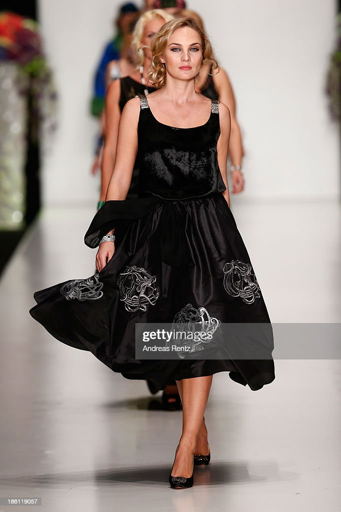 A model walks the runway at the ELENA SOUPROUN By Elena Suprun show during Mercedes-Benz Fashion Week Russia S/S 2014 on October 28, 2013 in Moscow, Russia.