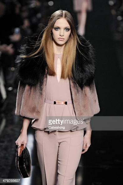 A model walks the runway at the Elie Saab Autumn Winter 2014 fashion show during Paris Fashion Week on March 3 2014 in Paris France