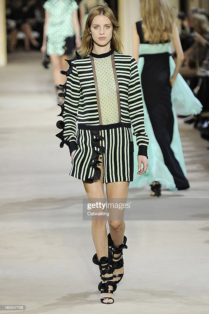 A model walks the runway at the Emanuel Ungaro Spring Summer 2014 fashion show during Paris Fashion Week on September 30, 2013 in Paris, France.