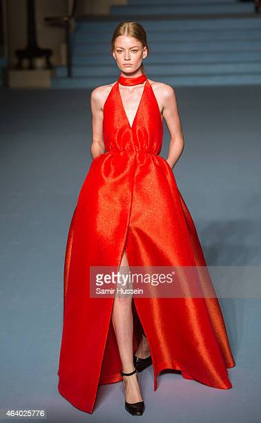 A model walks the runway at the Emilia Wickstead show during London Fashion Week Fall/Winter 2015/16 at The Banking Hall on February 21 2015 in...