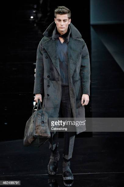 A model walks the runway at the Emporio Armani Autumn Winter 2014 fashion show during Milan Menswear Fashion Week on January 13 2014 in Milan Italy