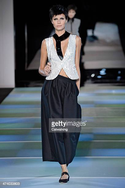 A model walks the runway at the Emporio Armani Autumn Winter 2014 fashion show during Milan Fashion Week on February 21 2014 in Milan Italy