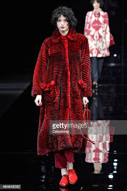 A model walks the runway at the Emporio Armani Autumn Winter 2015 fashion show during Milan Fashion Week on February 27 2015 in Milan Italy