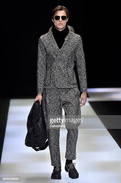 A model walks the runway at the Emporio Armani Autumn Winter 2016 fashion show during Milan Menswear Fashion Week on January 18 2016 in Milan Italy