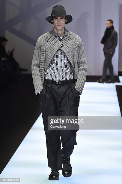 A model walks the runway at the Emporio Armani Autumn Winter 2017 fashion show during Milan Menswear Fashion Week on January 14 2017 in Milan Italy