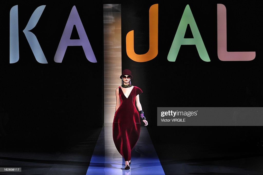 A model walks the runway at the Emporio Armani Ready to Wear Fall/Winter 2013-2014 fashion show as part of Milan Fashion Week Womenswear Fall/Winter 2013/14 on February 24, 2013 in Milan, Italy.