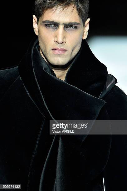A model walks the runway at the Emporio Armani show during Milan Men's Fashion Week Fall/Winter 2016/17 on January 18 2016 in Milan Italy