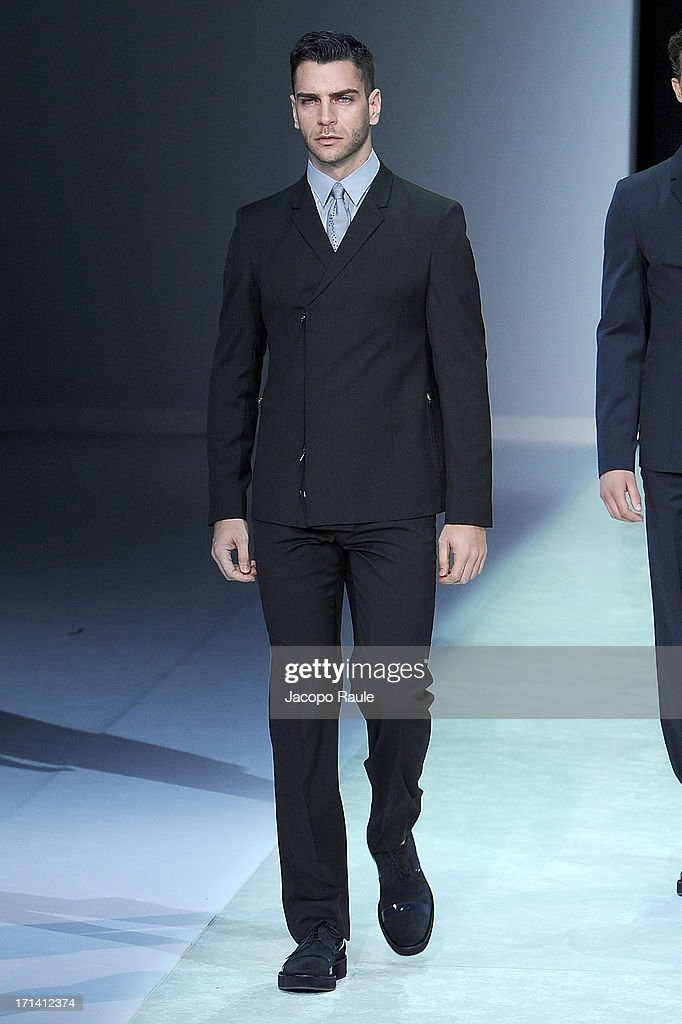 A model walks the runway at the Emporio Armani show during Milan Menswear Fashion Week Spring Summer 2014 show on June 24 2013 in Milan Italy