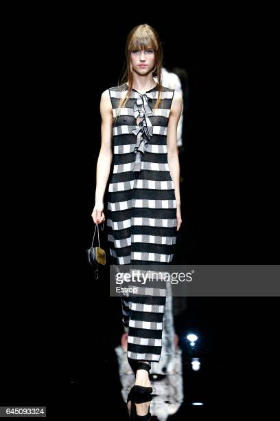 A model walks the runway at the Emporio Armani show during Milan Fashion Week Fall/Winter 2017/18 on February 24 2017 in Milan Italy